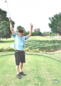 "Andrew ""Red"" Harris in victory mode after his 217-yard hole in one."