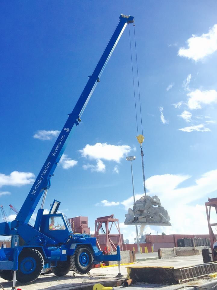 """The first Reef Cell modules being loaded on a truck that will become the Andrew """"Red"""" Harris Reef"""