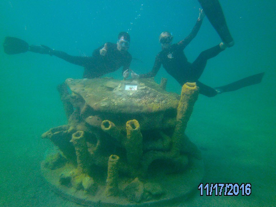 Martha and Scott Harris on a newly deployed reef module at Blue heron Bridge at Phil Foster Park