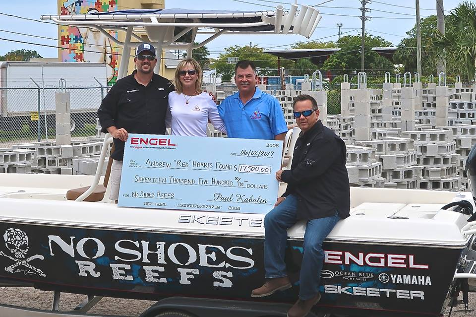 ENGEL Cooler and No Shoes reefs donating a check to Scott Harris